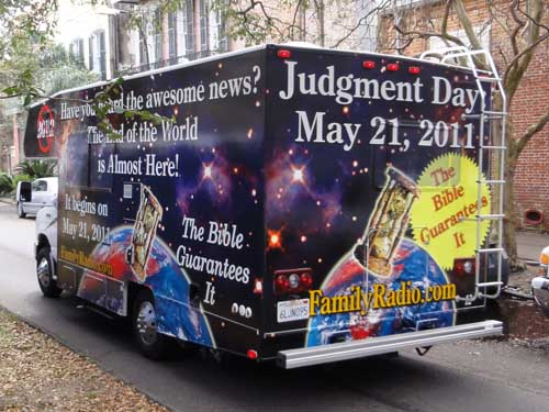 New Orleans. We saw five of these buses heading down Esplanade in a row.  Truck with announcement of the of