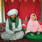 Afghan child bride with old man