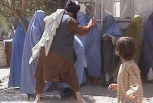 Taliban beat a woman in Kabul, Sep.2001 (RAWA)